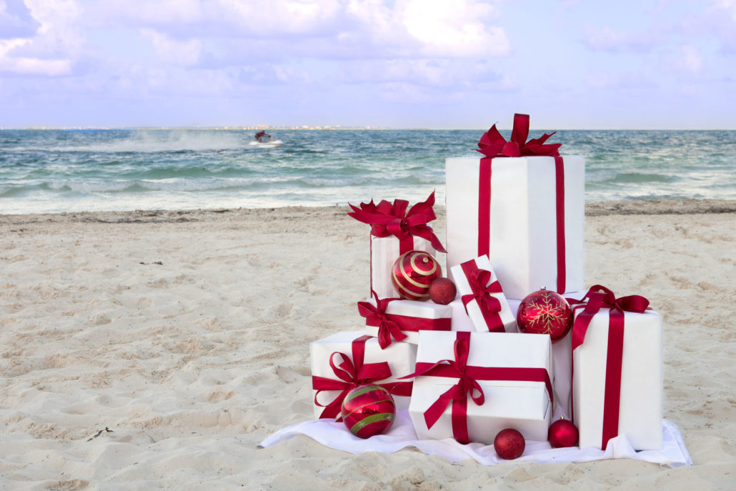 55009799 - christmas packages on a tropical beach.
